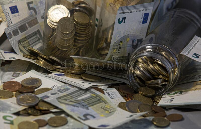 Glass jar of euro coins. And banknotes royalty free stock images