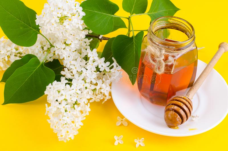Glass jar with floral aromatic honey royalty free stock photography