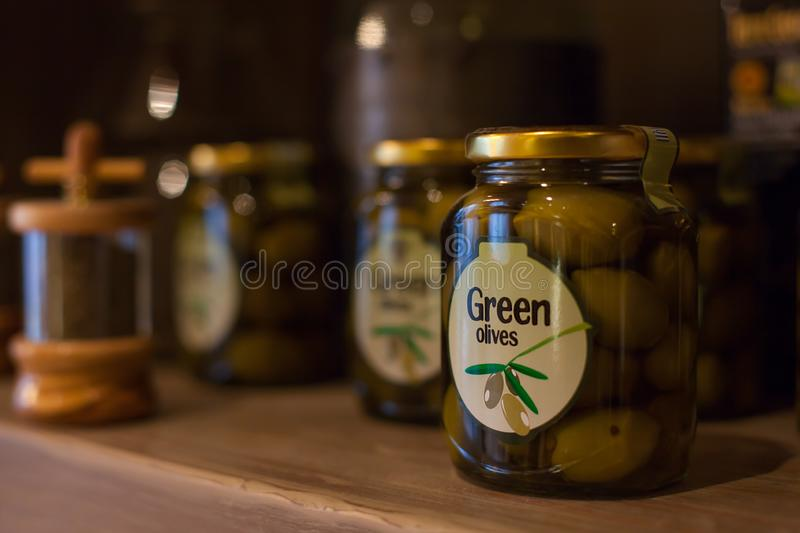 Glass jar with green olives. royalty free stock image