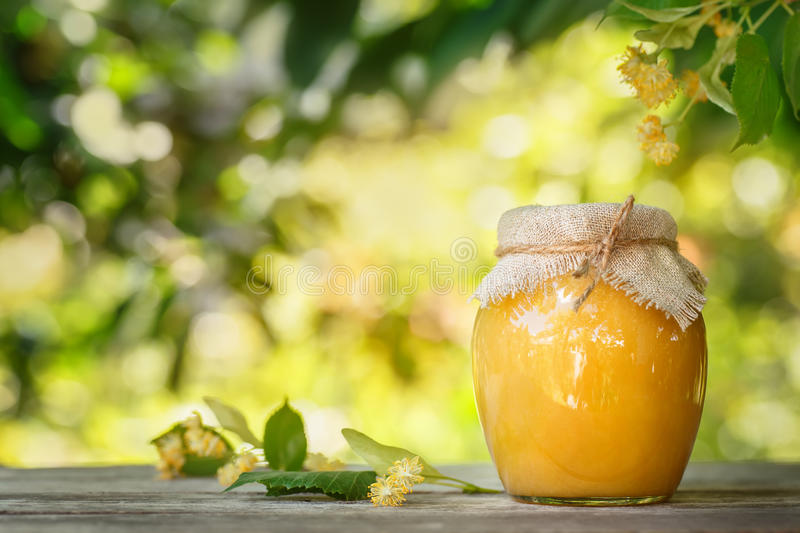 Glass jar of honey royalty free stock photo