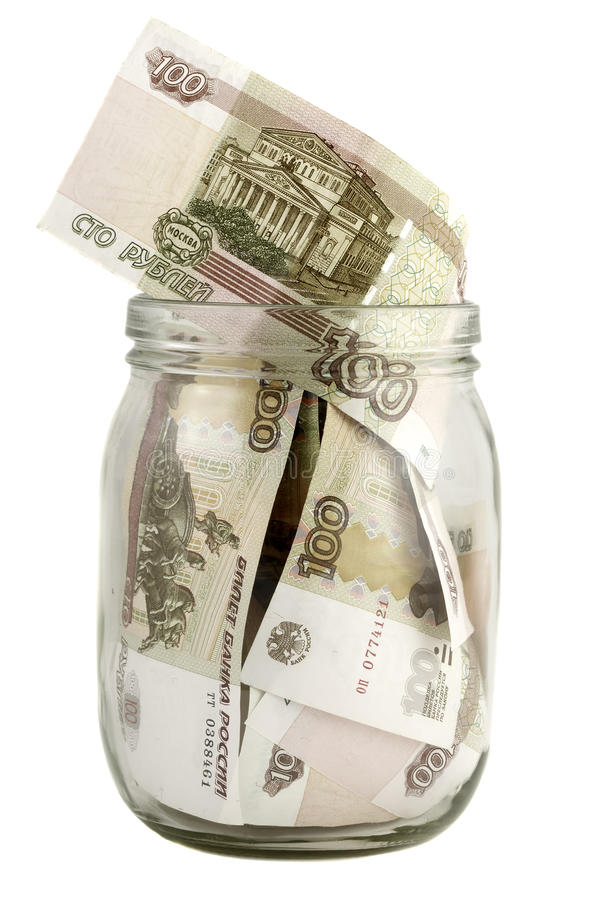 Glass jar with a hundred-ruble bills royalty free stock photography
