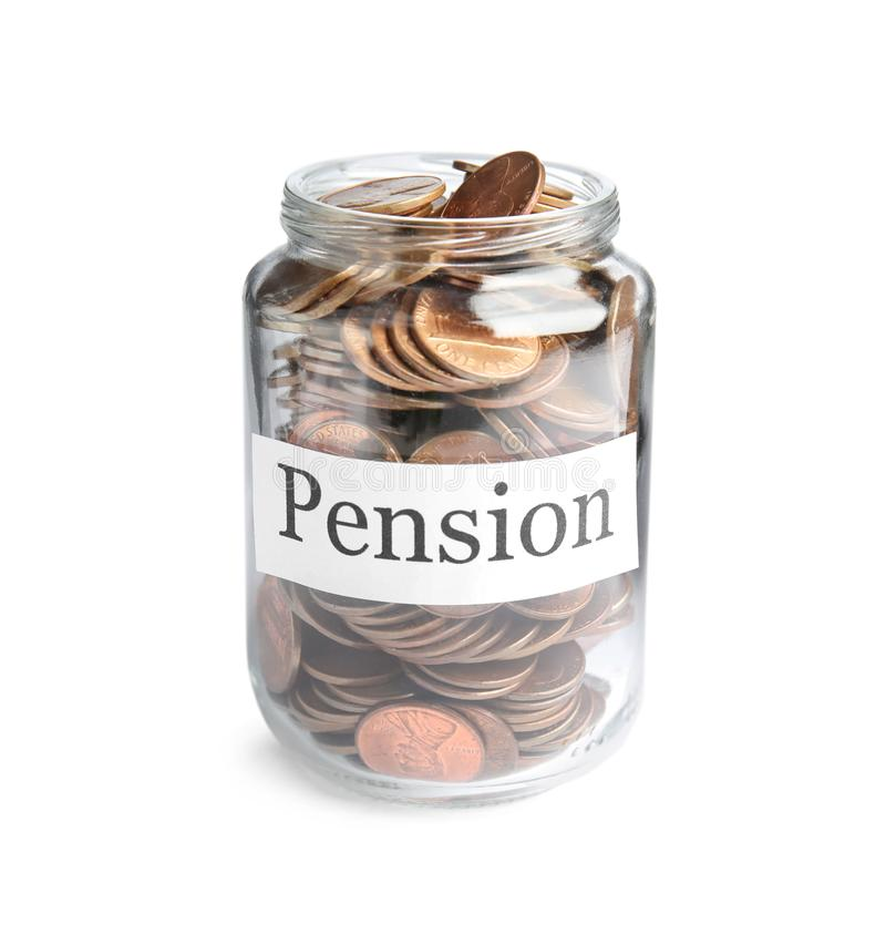 Glass jar with label PENSION and coins isolated. On white stock image
