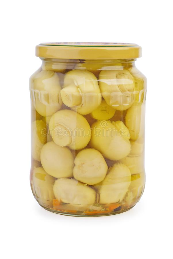 Glass jar with marinated white button mushrooms. Isolated on white background stock image