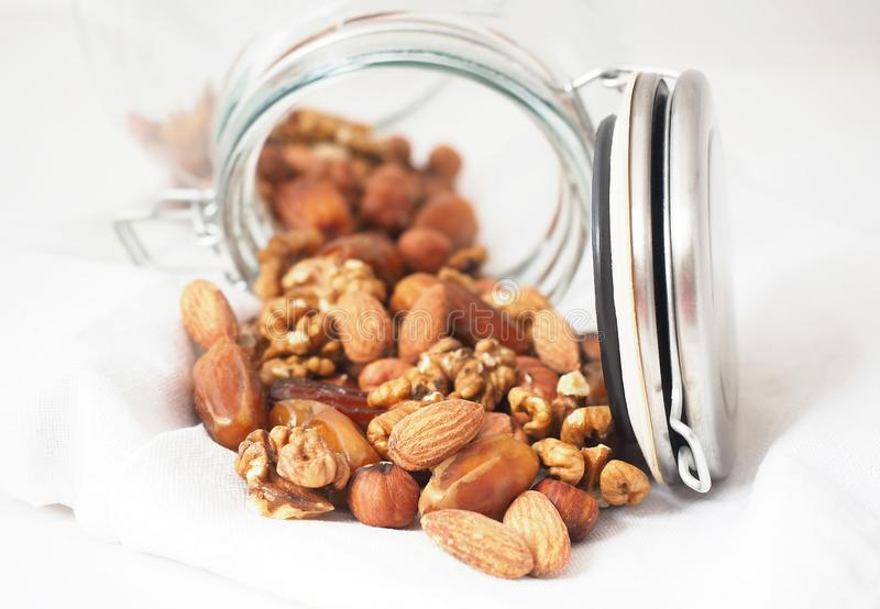 Glass jar of mixed nuts royalty free stock photos