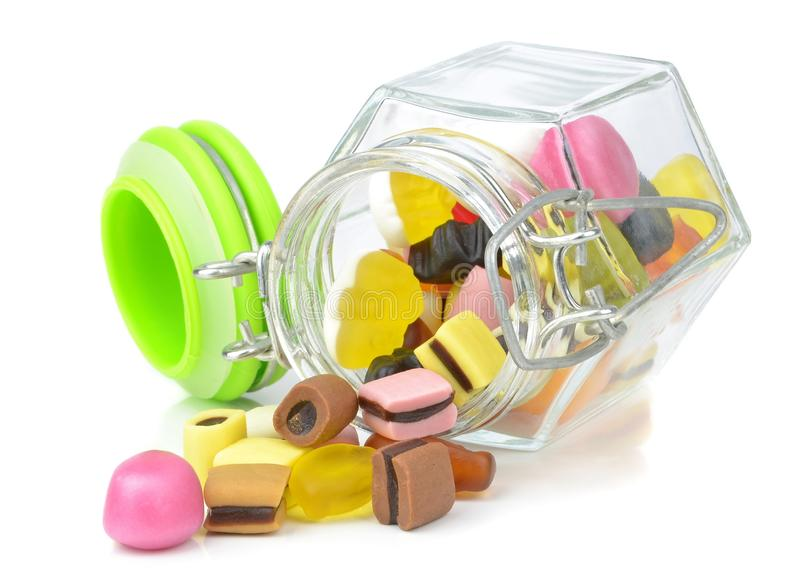 A glass jar of mixed sweets stock photos