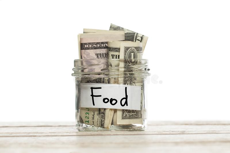 Glass jar with money for food.  royalty free stock photography