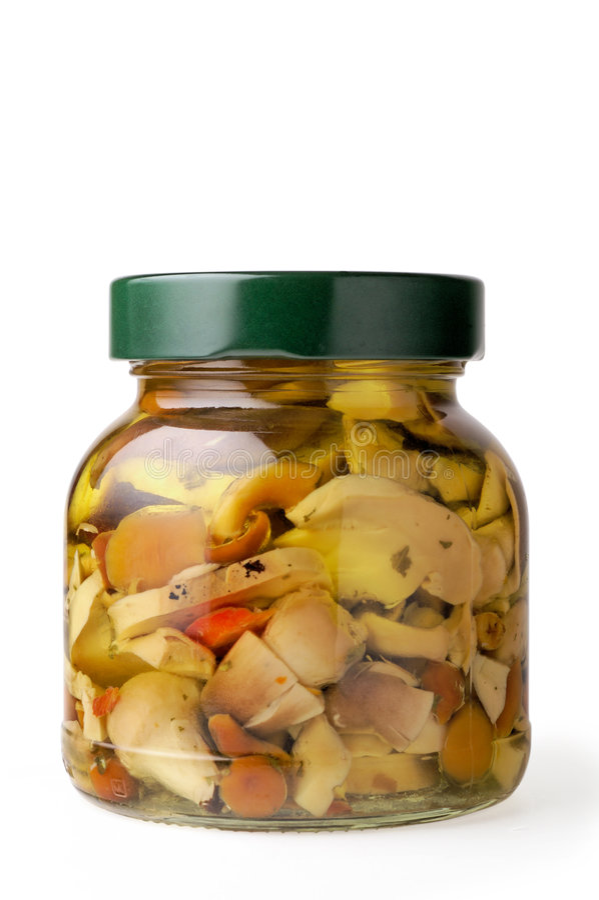 Glass jar of mushrooms royalty free stock photos