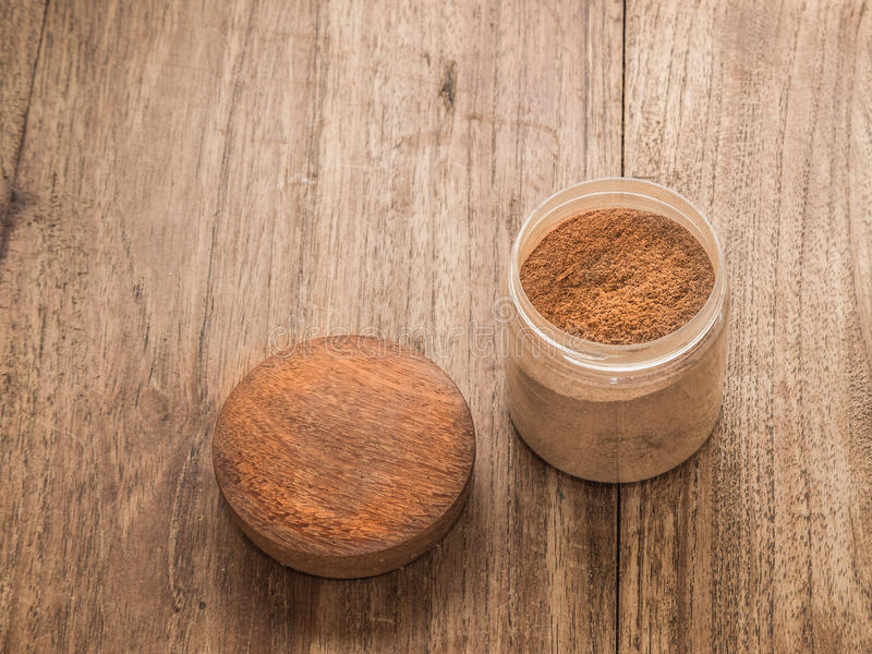 Glass jar open containing cinnamon propped stock photos
