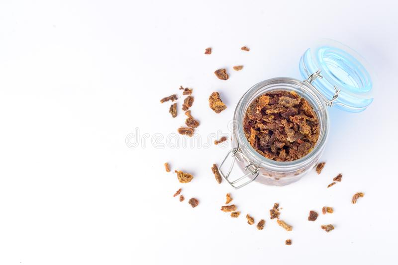 Glass jar with propolis granules. Bee glue. Bee products. Apitherapy. Apiculture. Glass jar with propolis granules. Bee glue. Bee products. Apitherapy royalty free stock photography