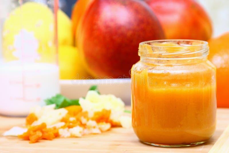 Glass jar with puree royalty free stock photo