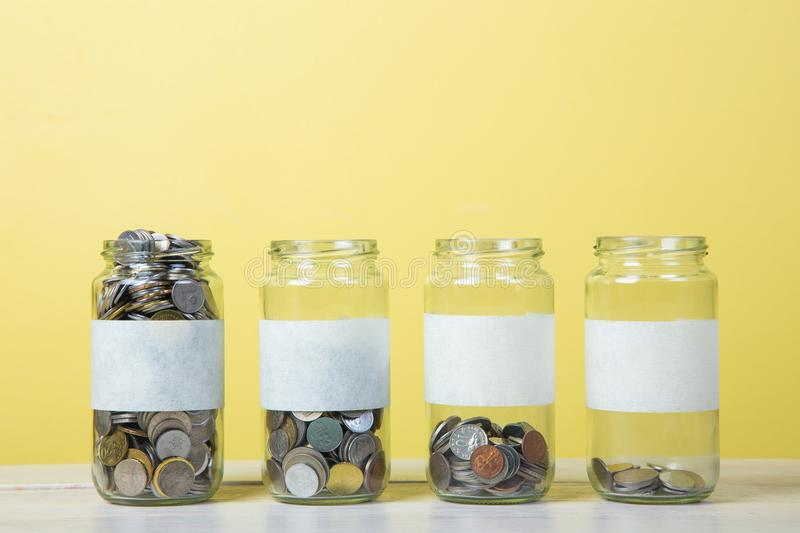 Glass jars with coins stock photo