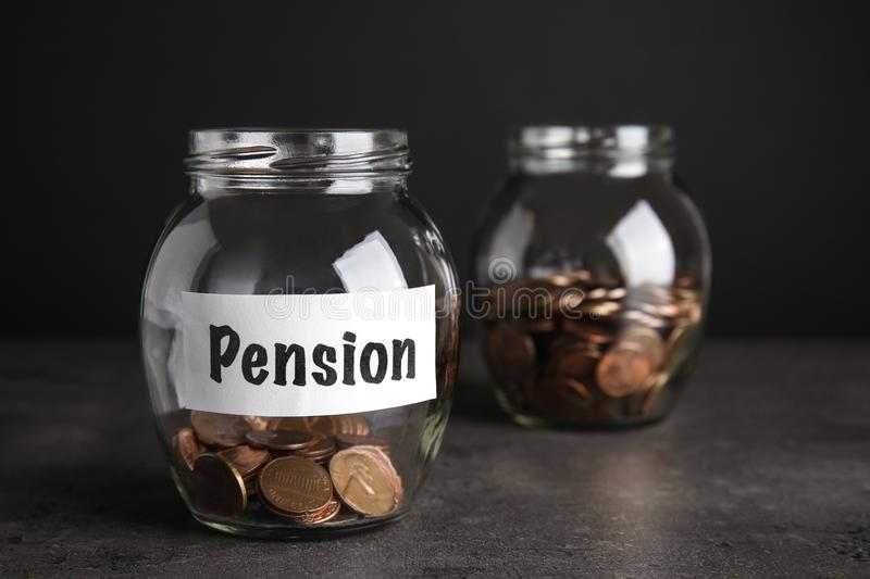 Glass jars with coins and label PENSION royalty free stock photo