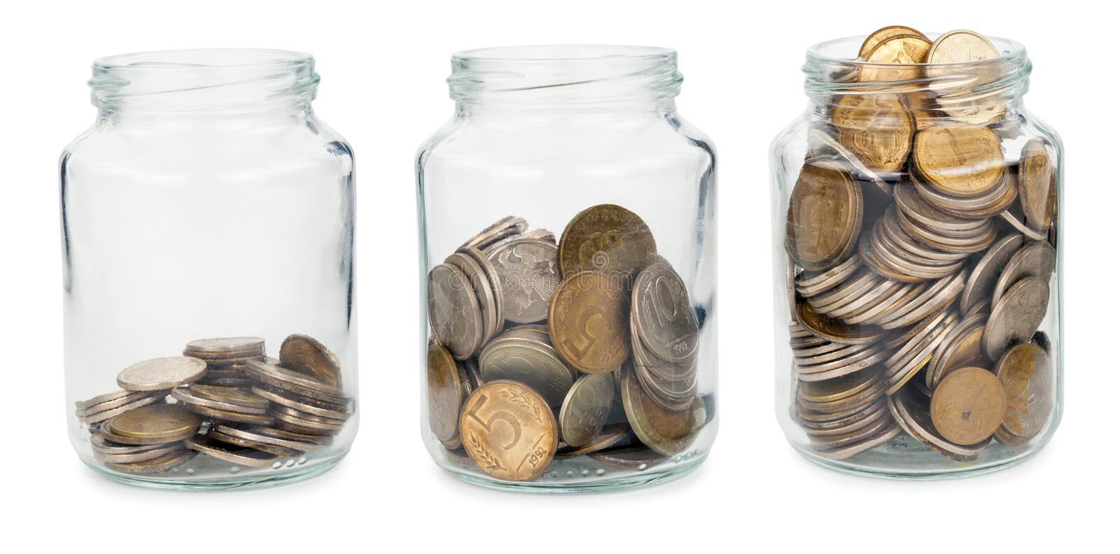 Glass jars with coins. On white background royalty free stock photos