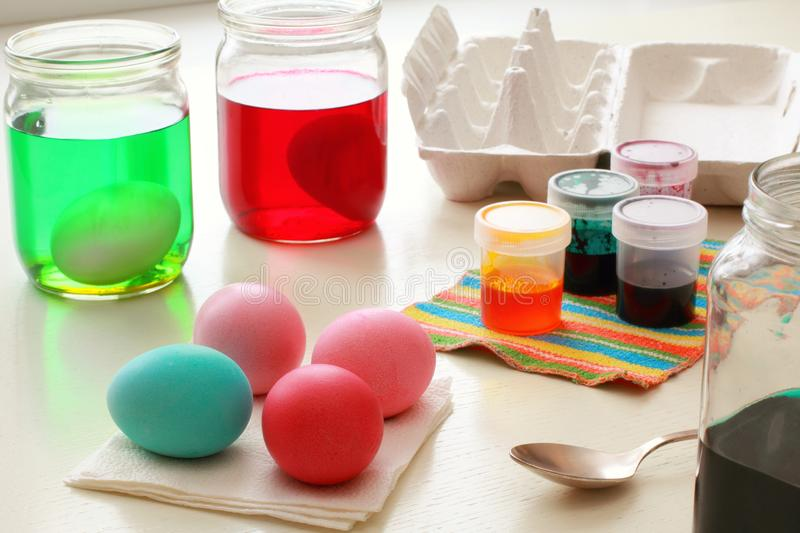 Dyeing Easter Eggs royalty free stock photography