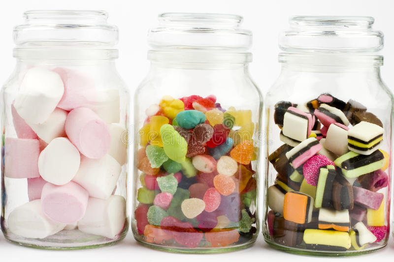 Glass jars filled with sweets mixture stock images