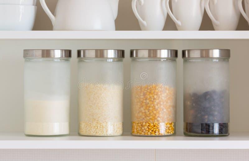 Glass jars with grain stock image
