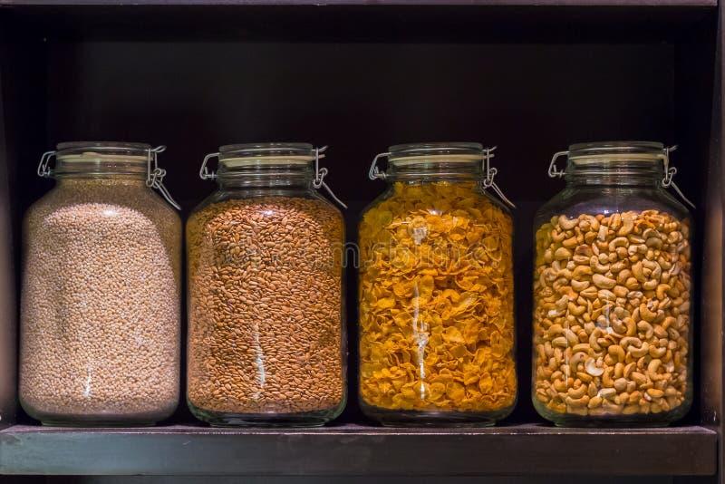 Glass jars with grain stock photos