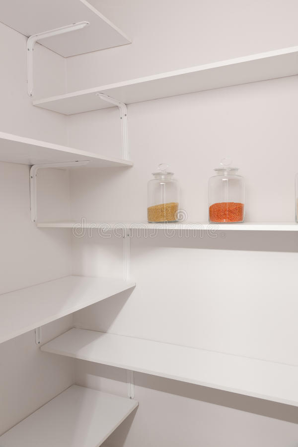 Free Glass Jars In Pantry Stock Photos - 24427493