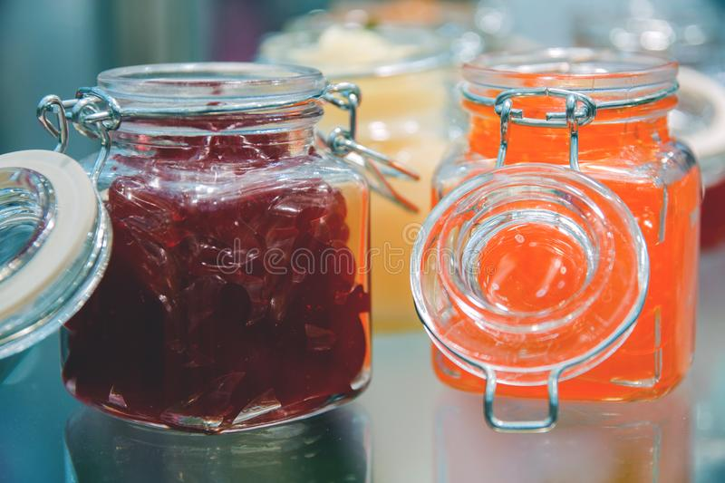 Glass jars of jelly on display stock images