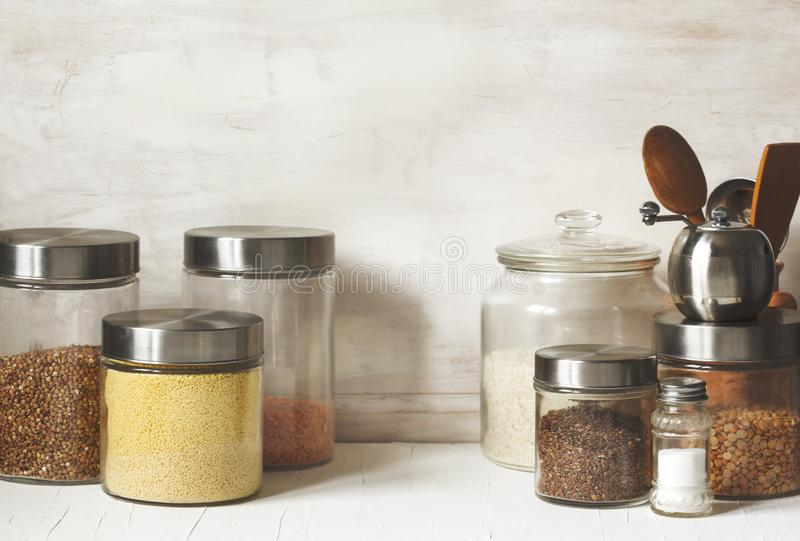 Glass jars with legumes, groats and useful seeds. Healthy vegetarian food. Clean eating concept. Copy space stock image