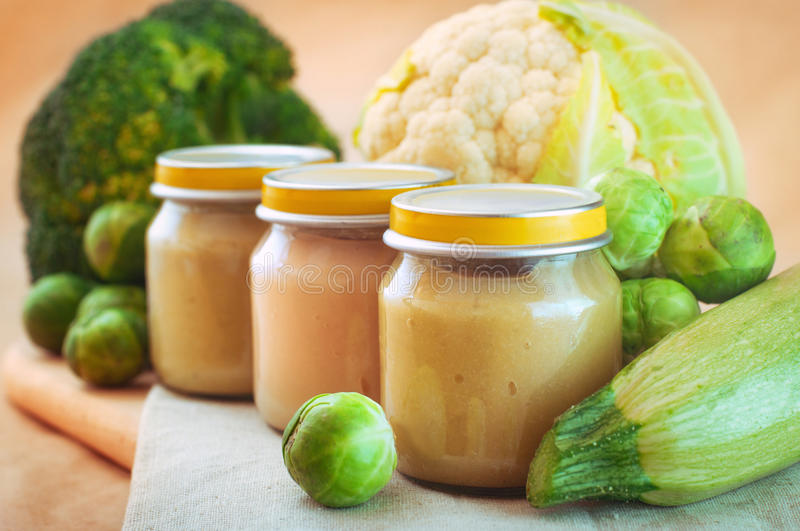 Download Glass Jars With Natural Baby Food Vegetablepuree On The Table Stock Photo - Image: 83713187