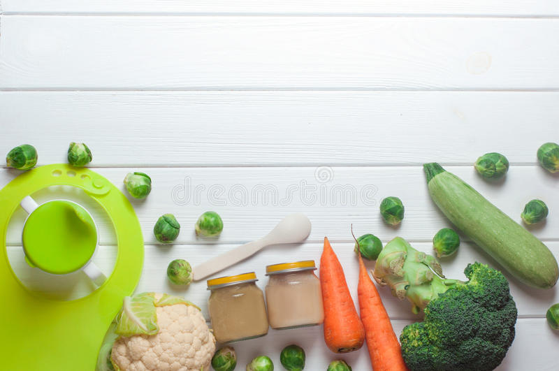Download Glass Jars With Natural Baby Food On The White Wood Table Stock Photo - Image: 83713178