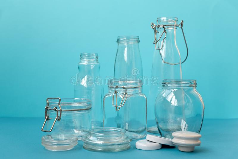 Glass jars standing on blue background. Eco friendly, reuse or zero waste concept royalty free stock image