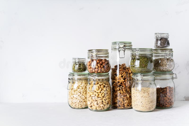 Glass jars with Superfoods nuts and cereals stacked on top of each other royalty free stock photography