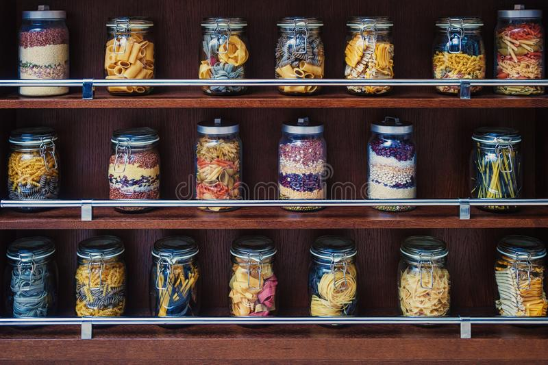 glass jars with various varicoloured types of pasta royalty free stock photo
