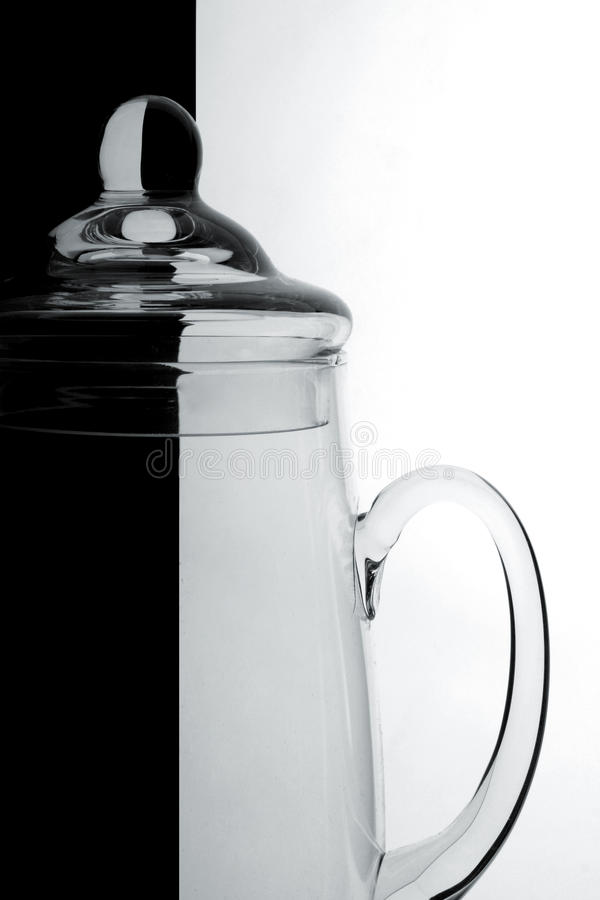 Glass jug on a black-and-white background stock photos