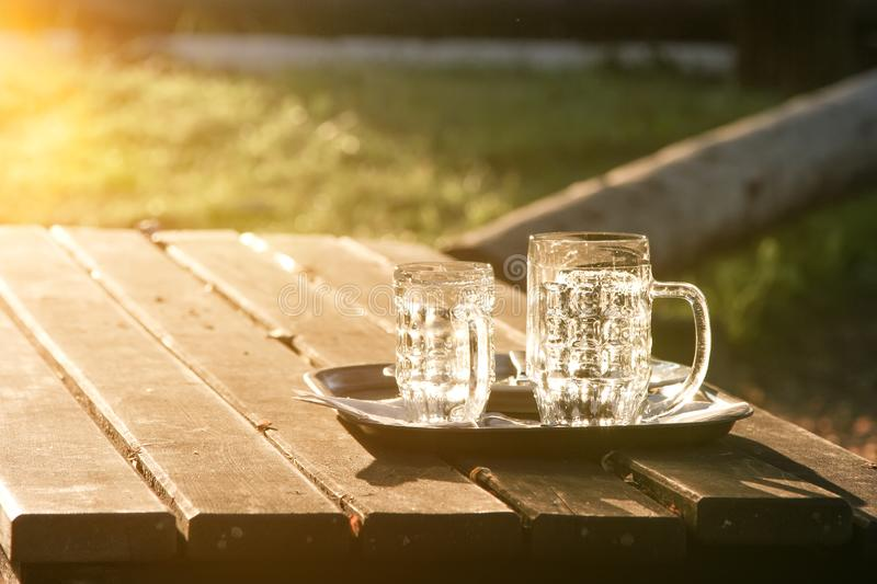 Glass jugs empty in the sunset. An image of glass jugs empty in the sunset royalty free stock photo