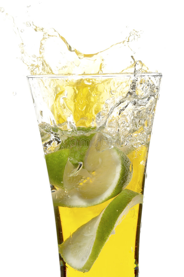 Glass with juice and lime stock images