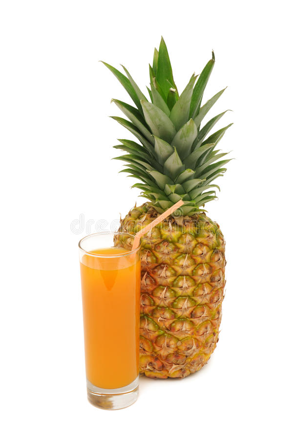Glass with juice and pineapple stock photo