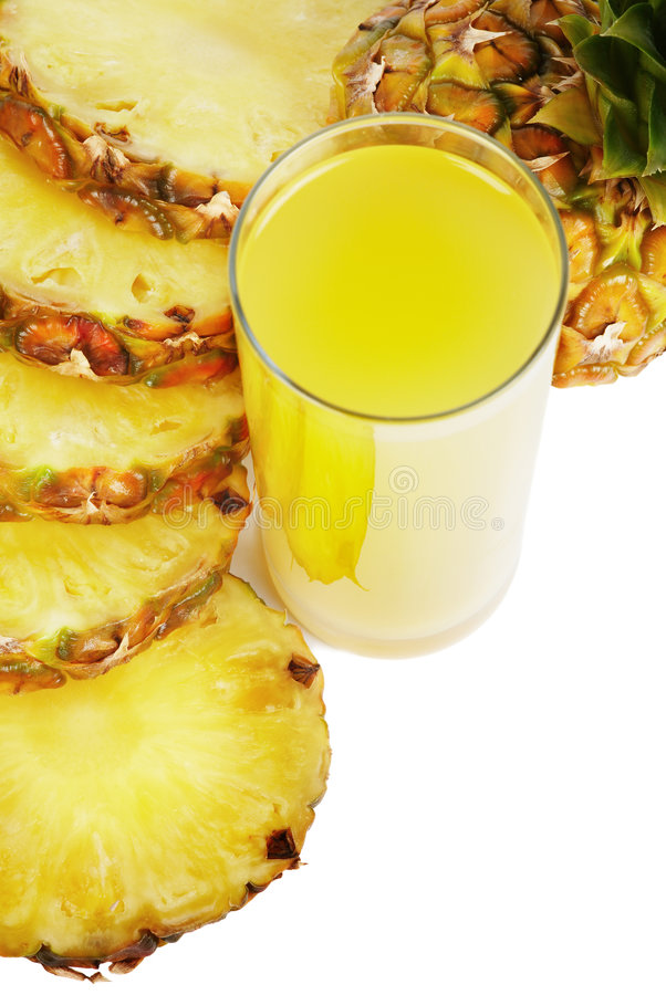 Glass of juice and pineapple royalty free stock photography