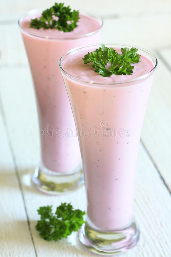 Glass of kefir with chilled beet royalty free stock image