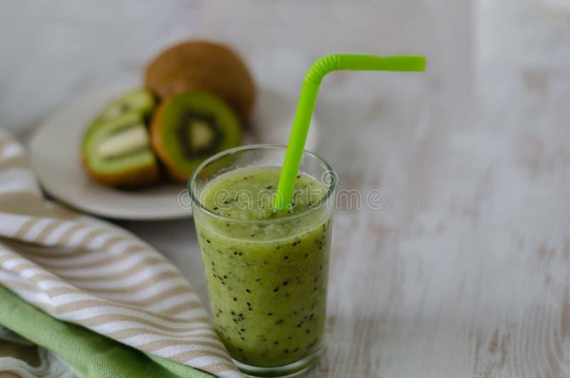 Fresh kiwi juice and slices of kiwi are on white background. royalty free stock photography