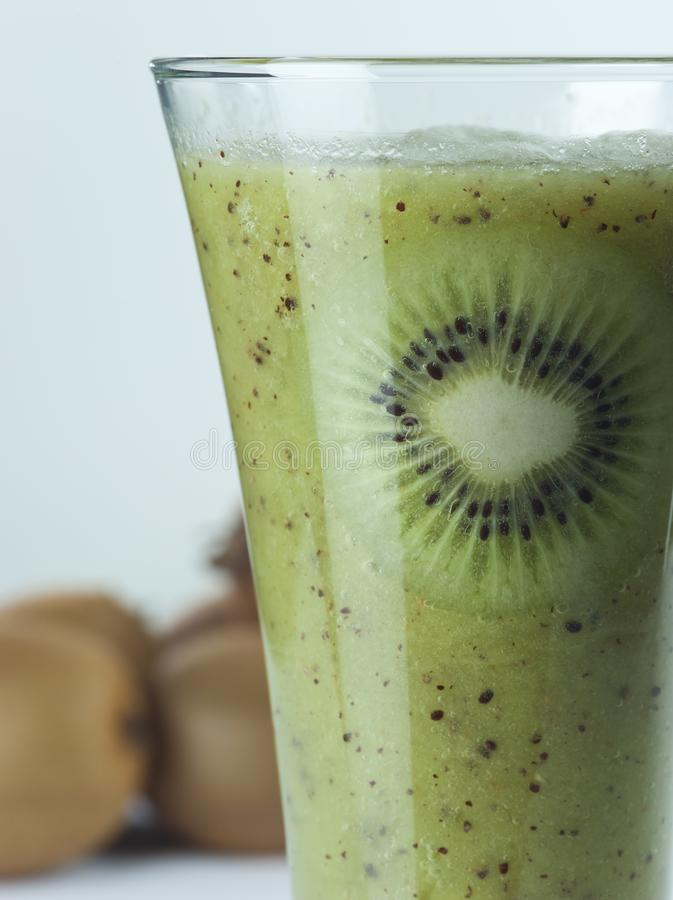 A glass of kiwi Juice with slices and fruits royalty free stock photos