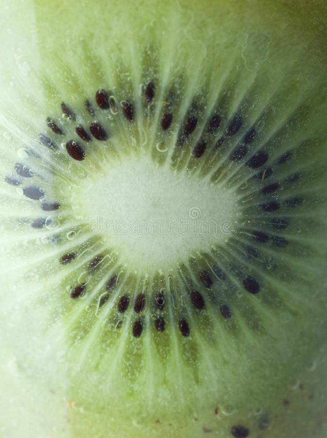 A glass of kiwi Juice with slices and fruits stock photo