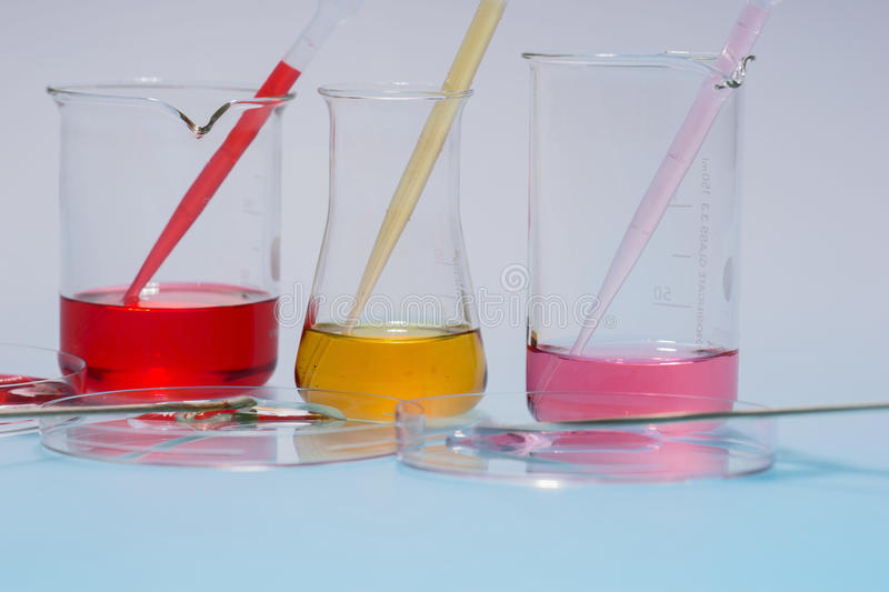 Glass laboratory apparatus with color water. On the table royalty free stock photo