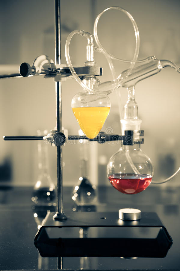 Glass laboratory apparatus. With liquid samples stock photos