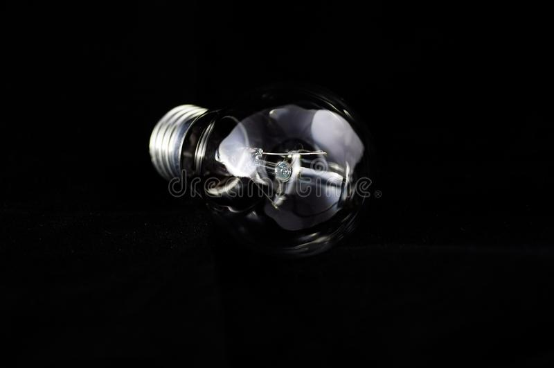 Glass lamp on a black background royalty free stock image