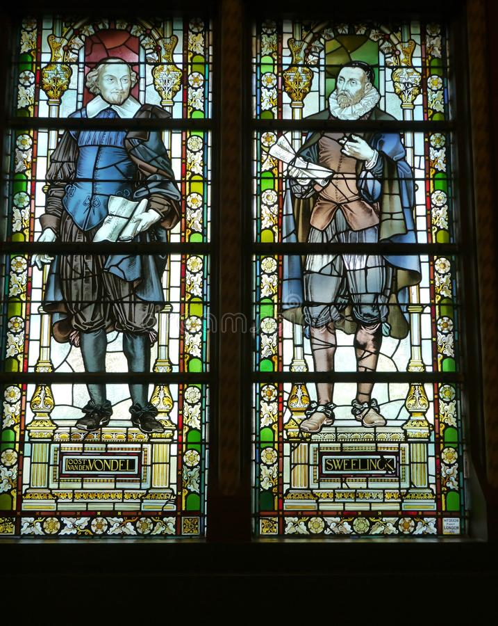 Glass-in-lead. Stained glass of the Rijksmuseum or State museum in Amsterdam in the Netherlands royalty free stock image