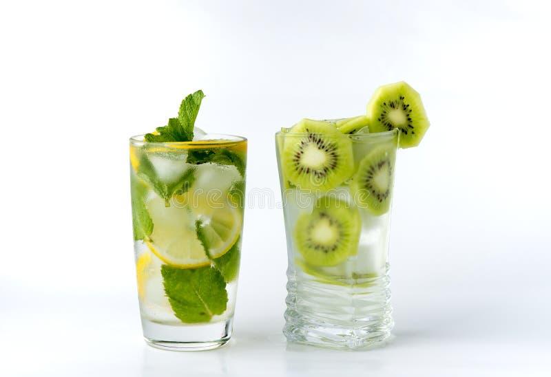 A glass with lemon and ice kiwi royalty free stock photos