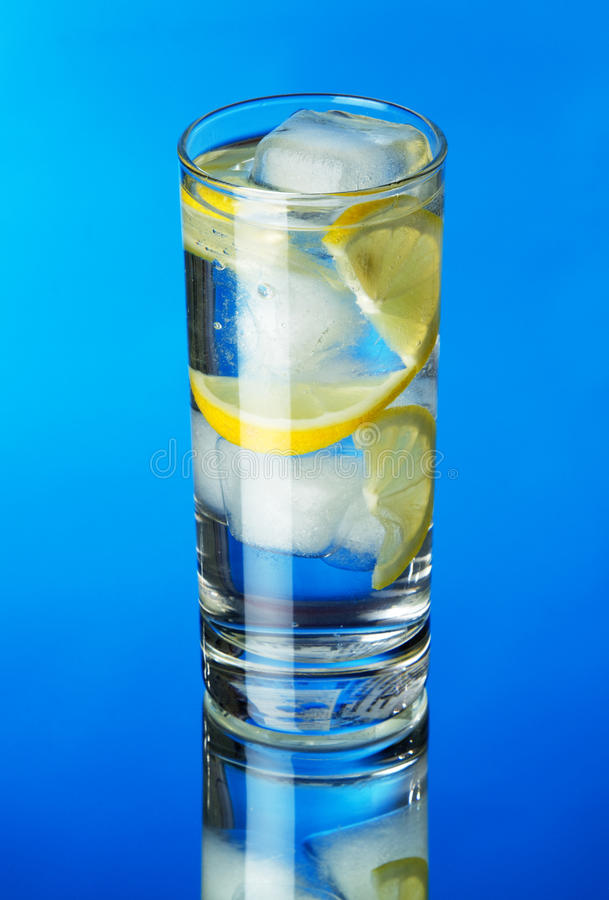 Glass Of Lemon Ice Water On Blue Background Royalty Free Stock Image