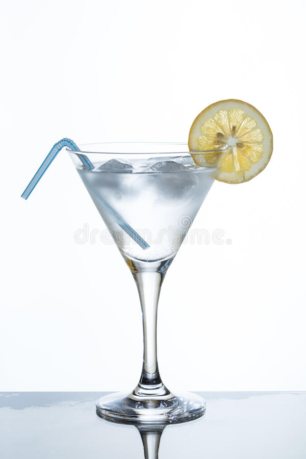 Glass of lemonade and ice. With slice of lime stock image