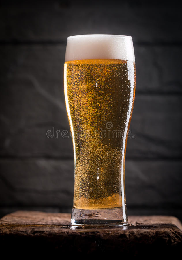 Glass of light beer stock images