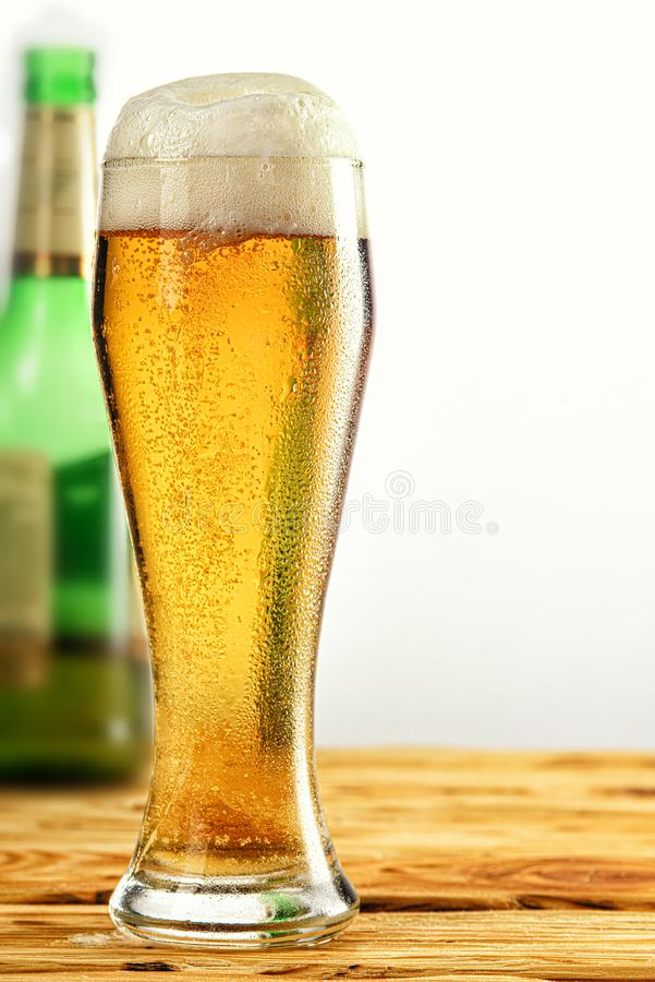 A glass of light beer close-up royalty free stock photo