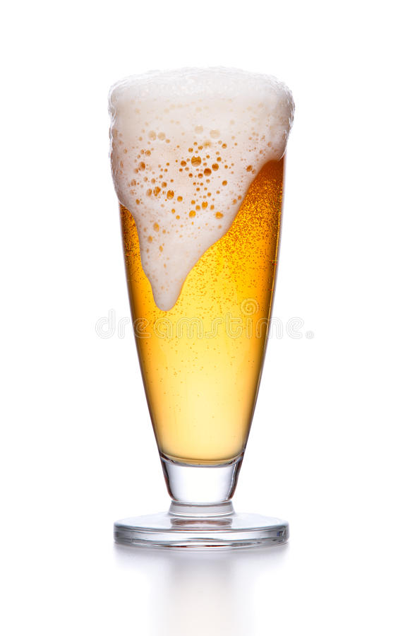 glass of light beer foam. lager beer in a glass beaker with fresh bubbling foam isolate. royalty free stock photography