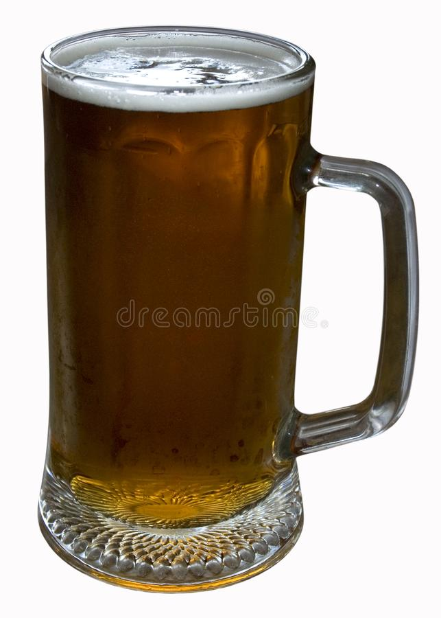 Faceted glass of light beer stock photos