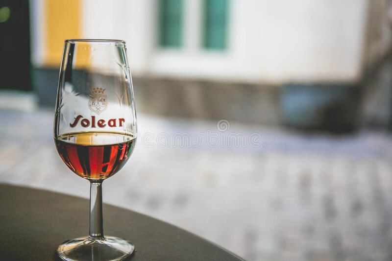 Glass of liquor on table royalty free stock images